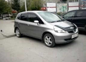 Отзыв об автомобиле Honda FIT  (Хонда ФИТ), 1,5-L vtek, хэтчбек, АКПП,  2002 г.в.